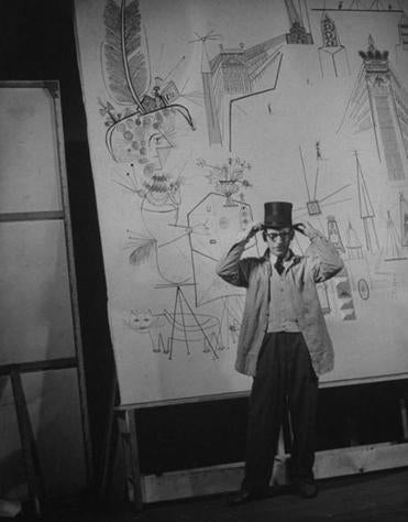Artist Saul Steinberg and a mural.